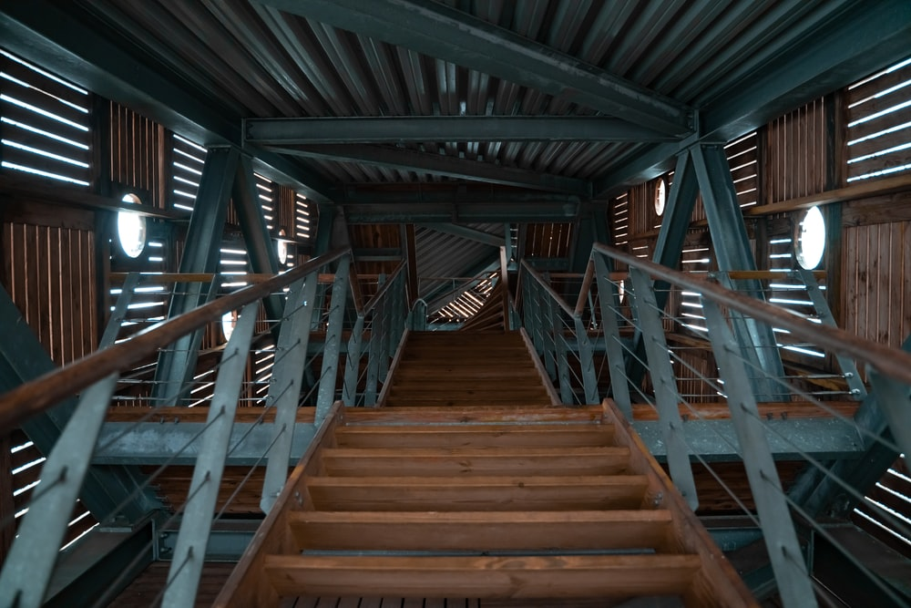 brown wooden stairs with brown wooden railings