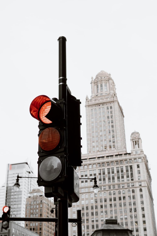 black traffic light near white concrete building during daytime