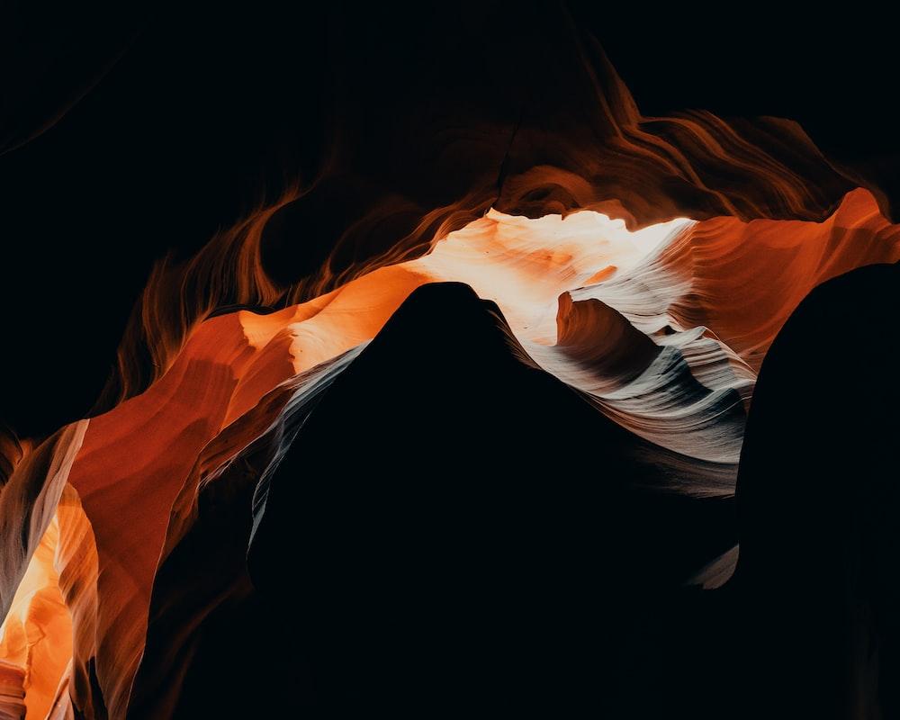 orange and black flame in a dark room
