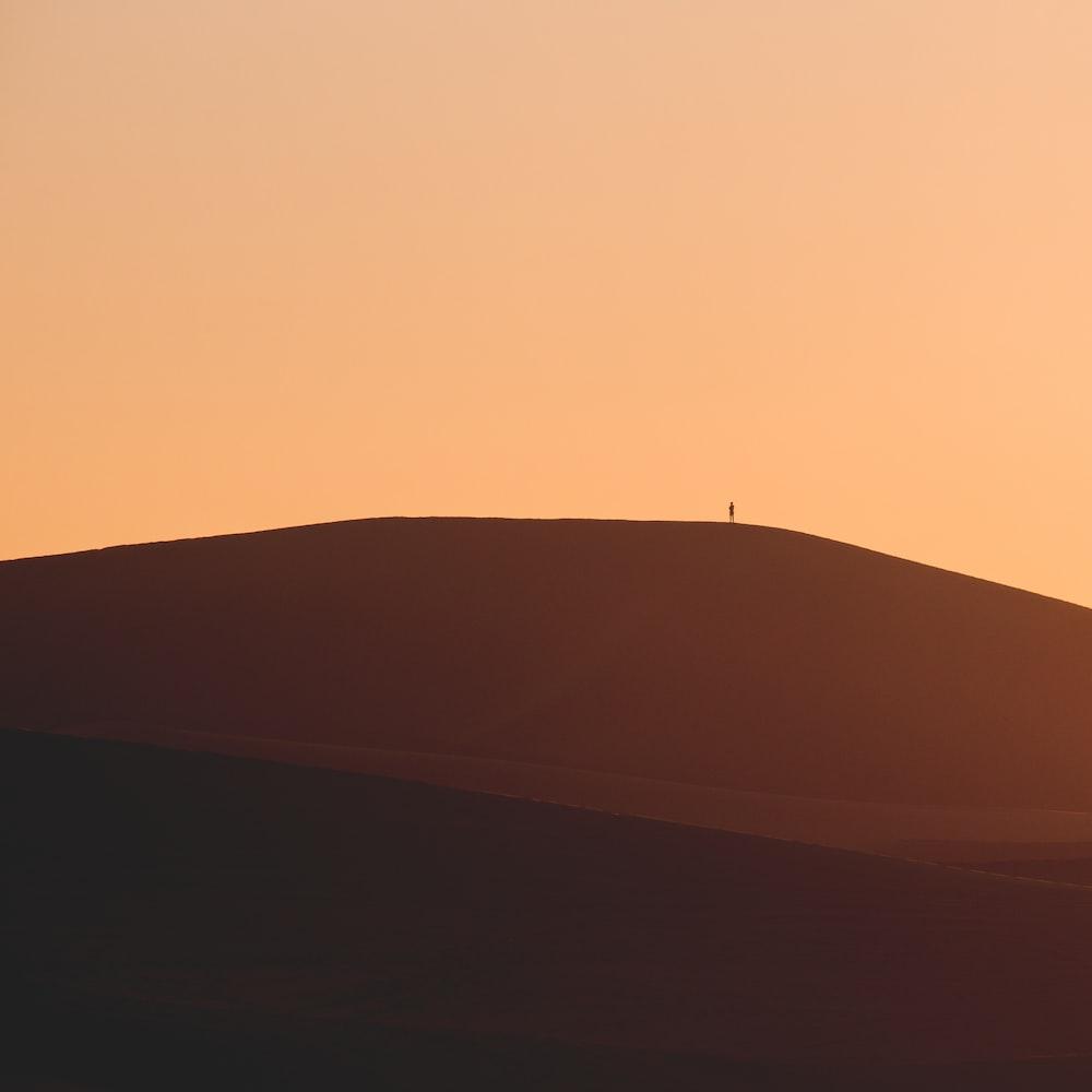brown sand under orange sky