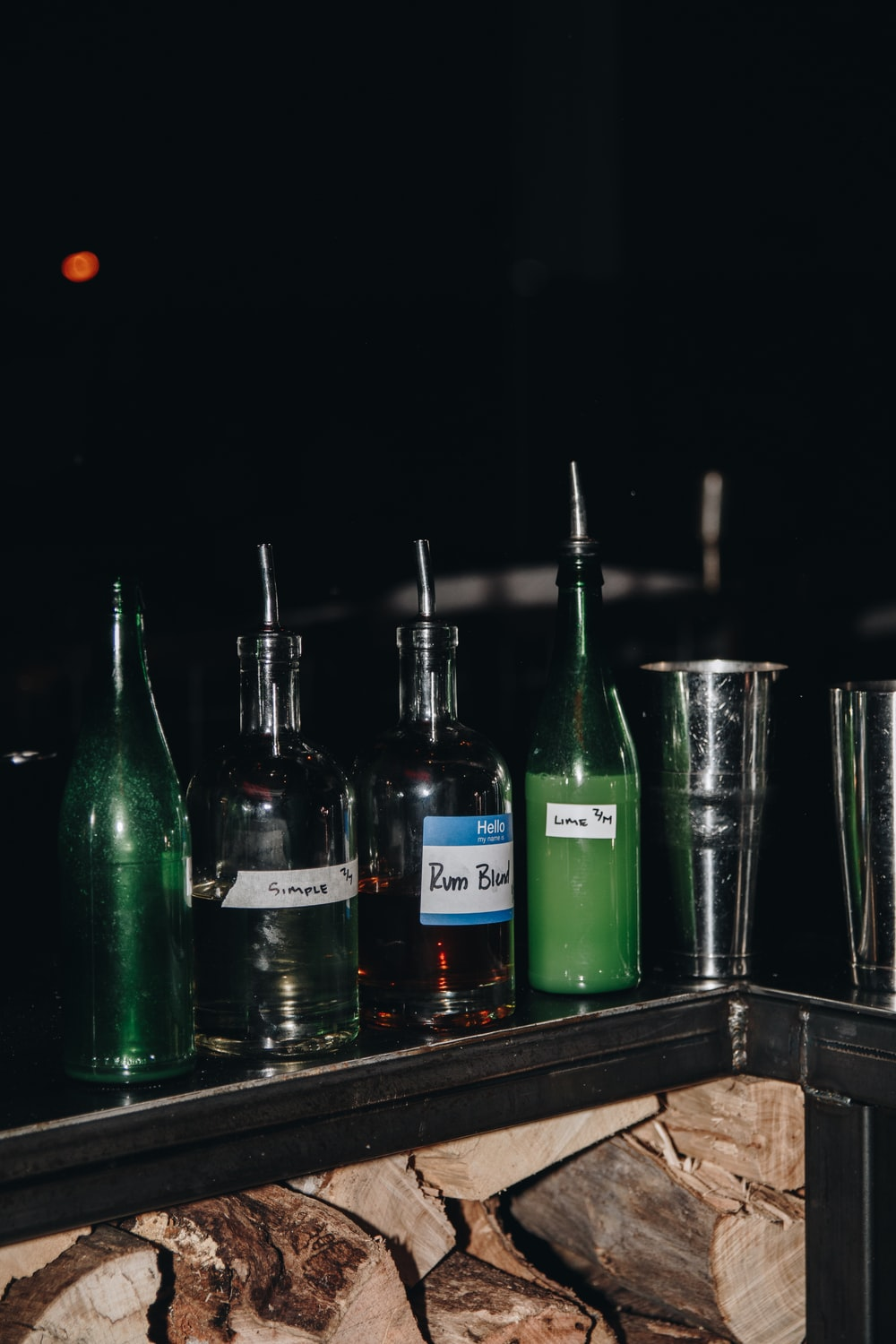 green glass bottles on brown wooden table
