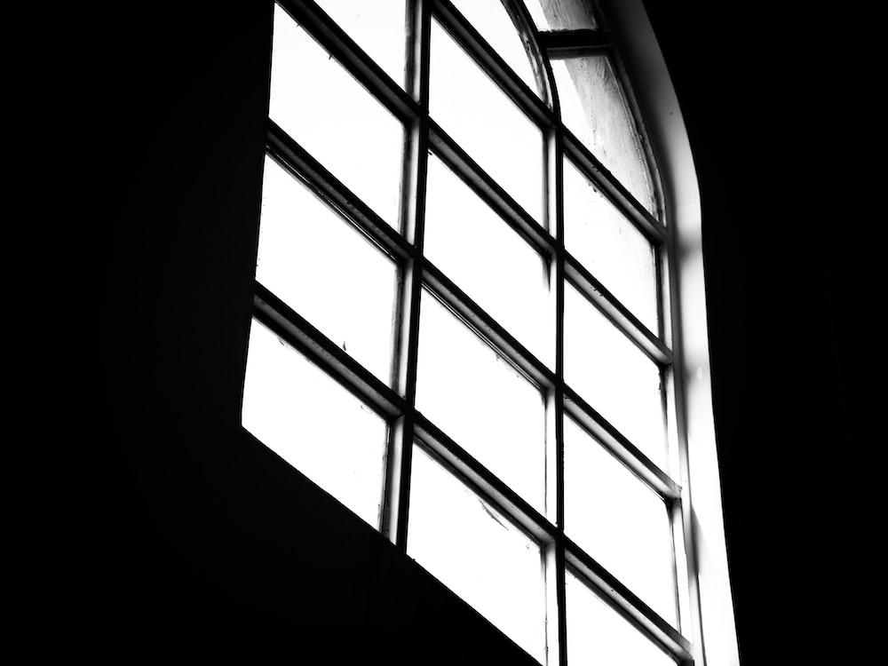 black metal window frame during daytime
