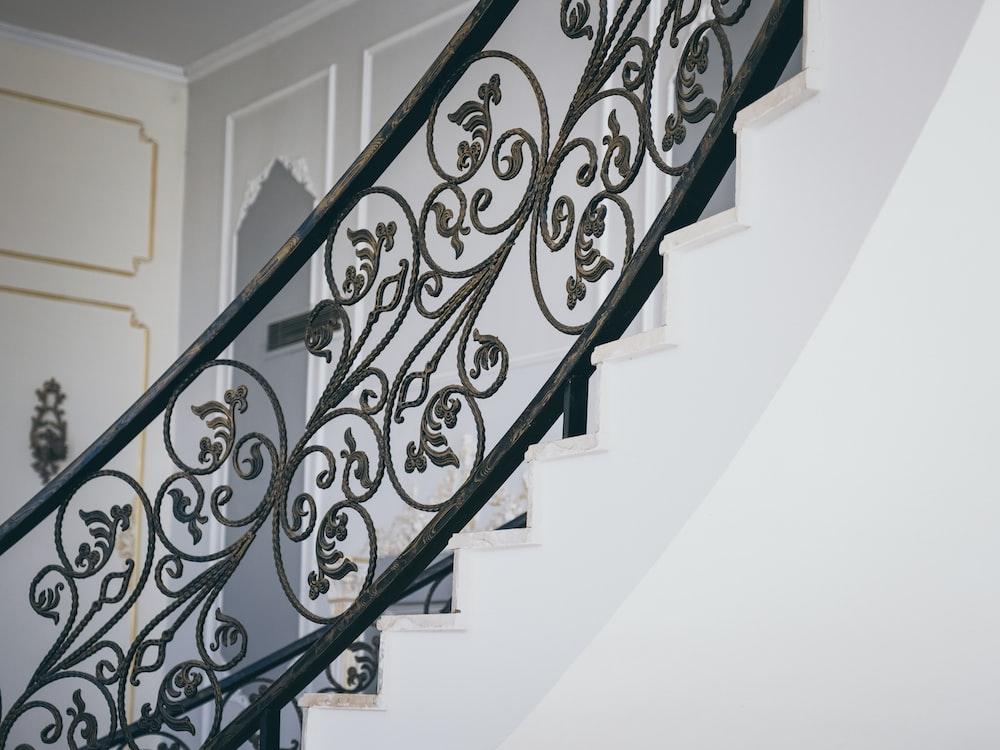 black metal spiral staircase railings