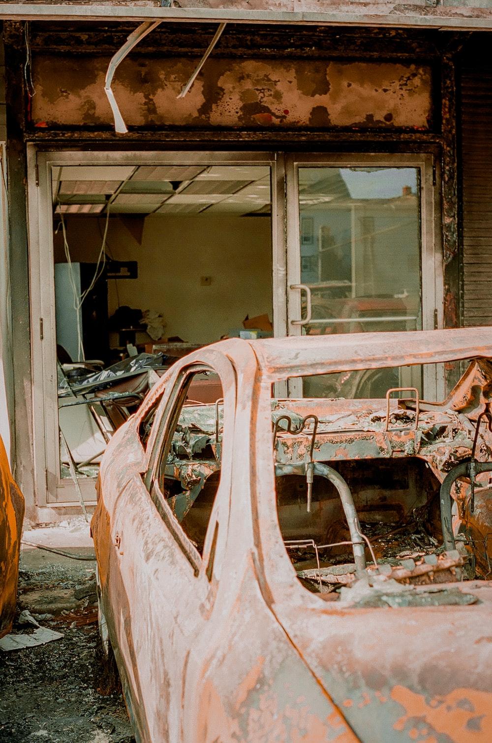 broken car in front of window