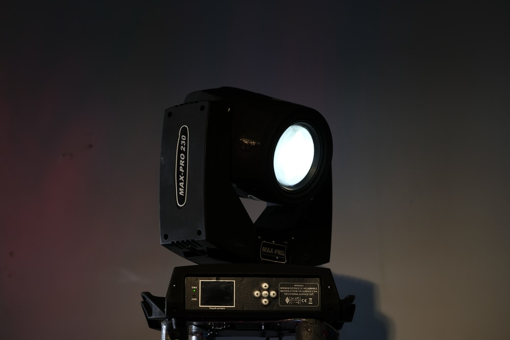 black and gray speaker on black surface