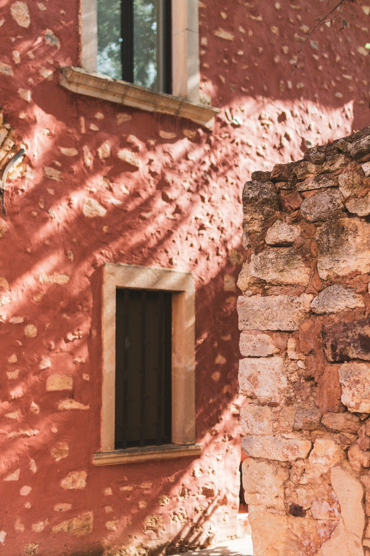 brown wooden window on brown brick wall