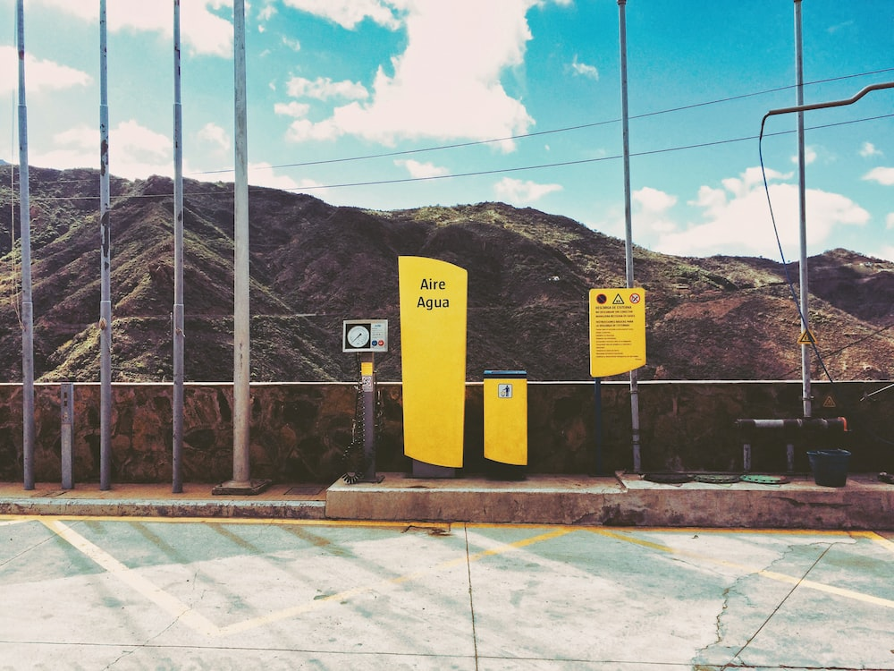 yellow and black caution sign
