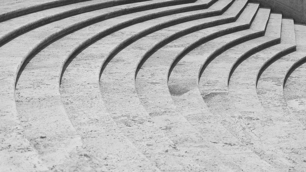 black metal fence on white sand