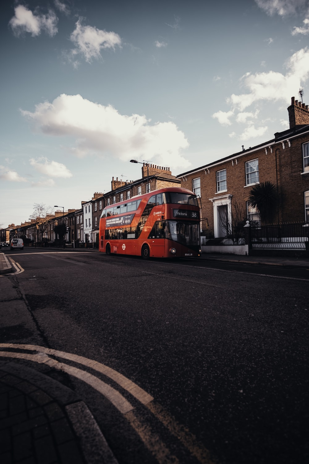 red bus on road near building during daytime