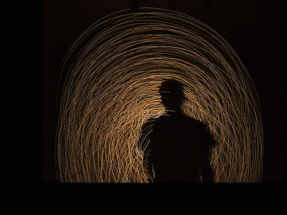 man standing on brown tunnel