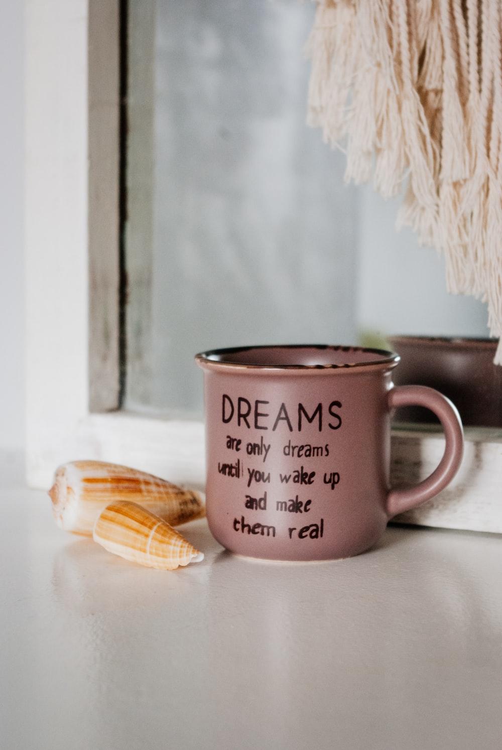 white ceramic mug beside brown wooden biscuit