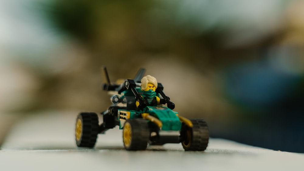 green and yellow lego toy