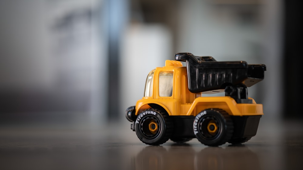 yellow and black truck toy