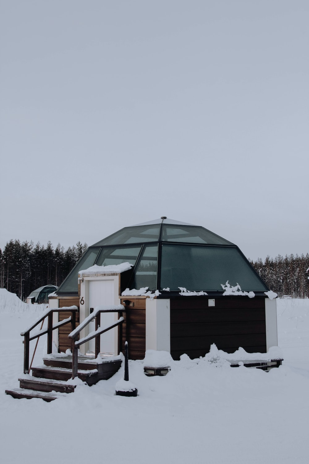 white and green dome tent on snow covered ground