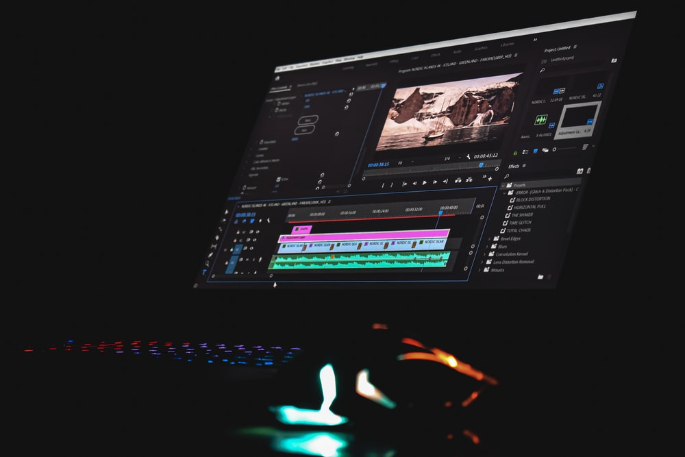 black laptop computer turned on displaying music player