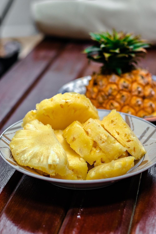 sliced pineapple on white ceramic plate