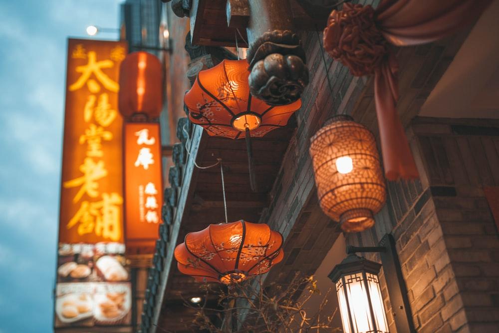 orange lantern lamp turned on during nighttime