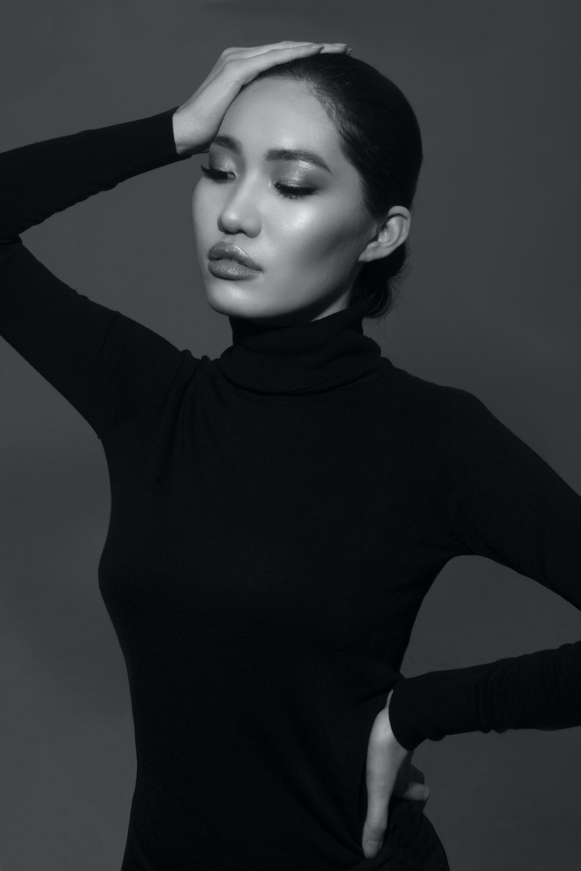 woman in black turtleneck long sleeve shirt