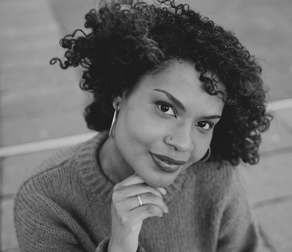 grayscale photo of woman in sweater