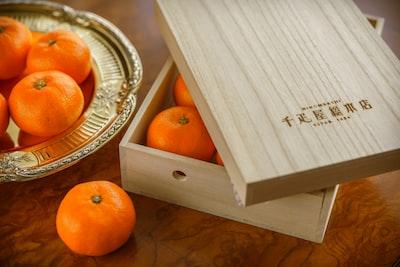 Tokyo orange fruit on stainless steel tray