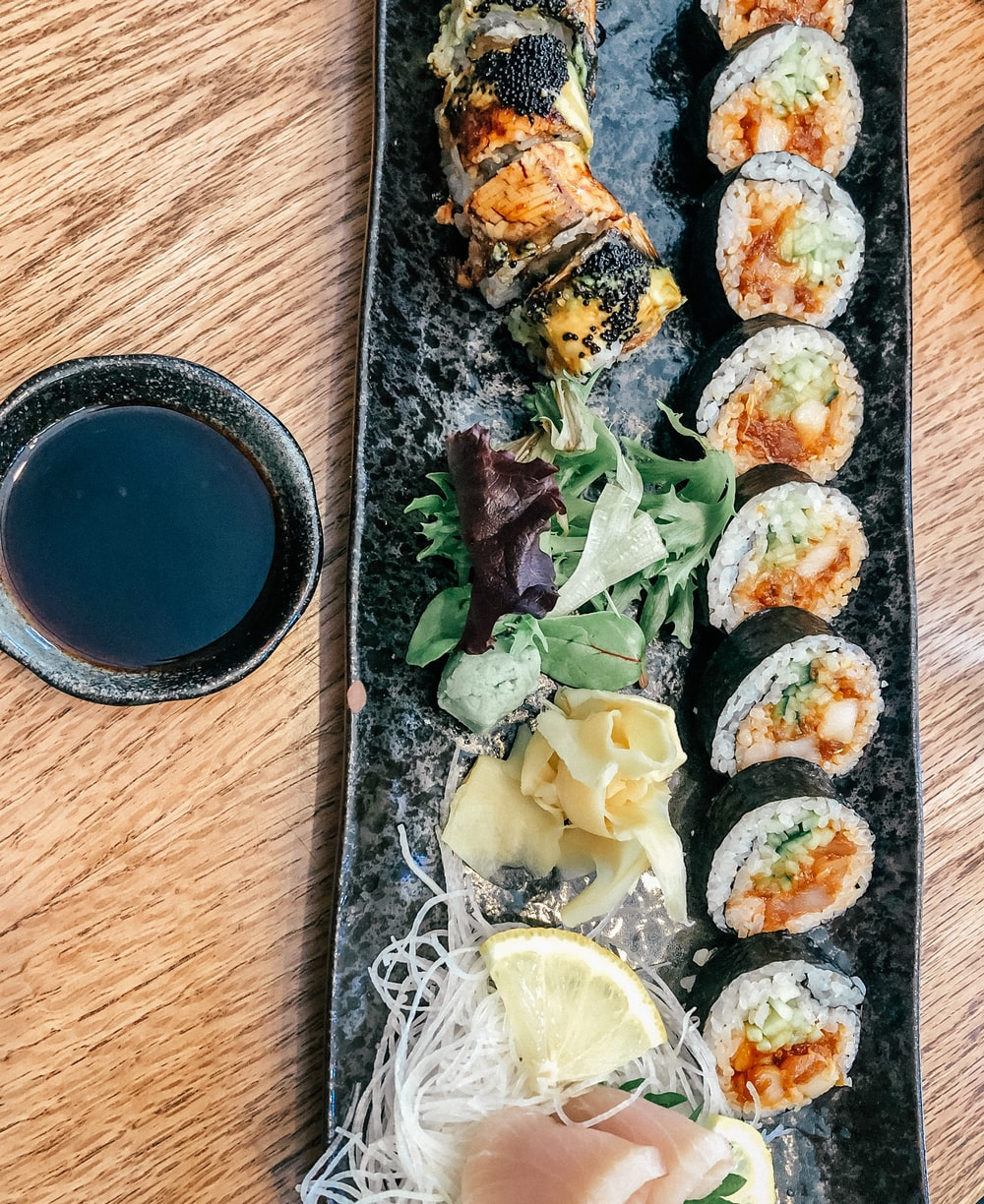 sushi on brown wooden table