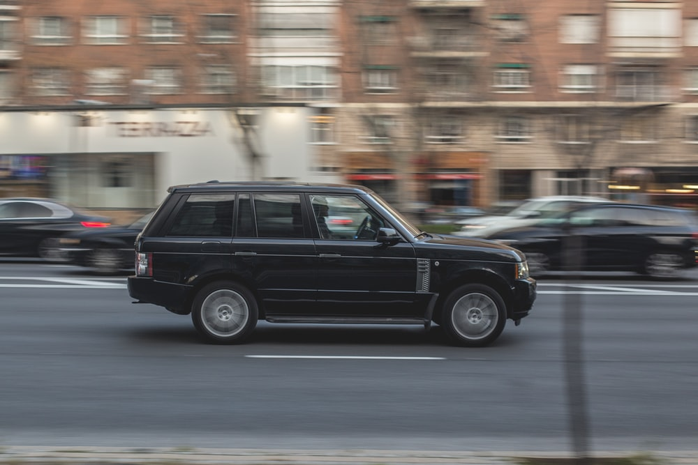 black suv on road during daytime