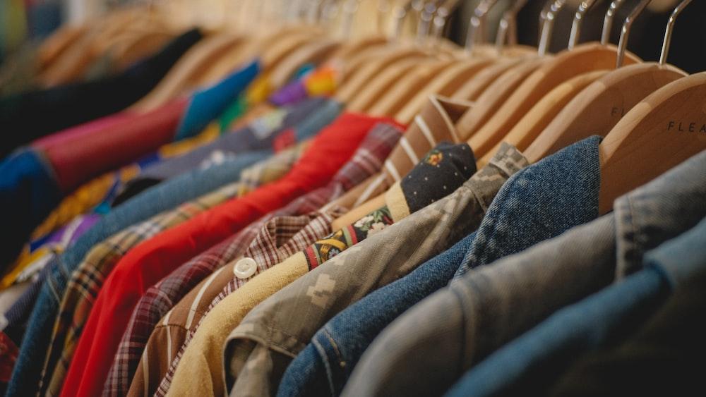 blue denim jeans on brown textile