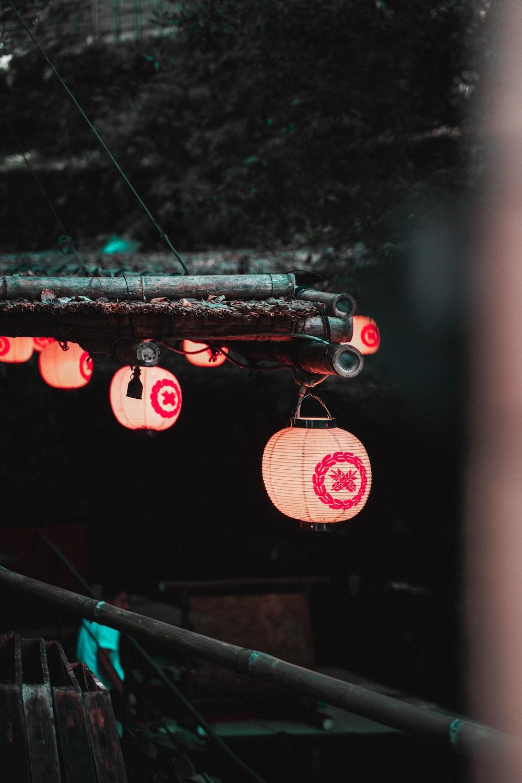red paper lantern on black metal bar