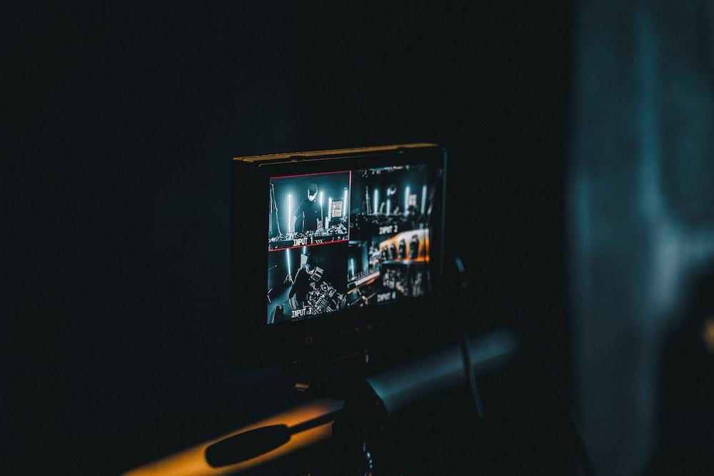 black flat screen tv turned on inside room