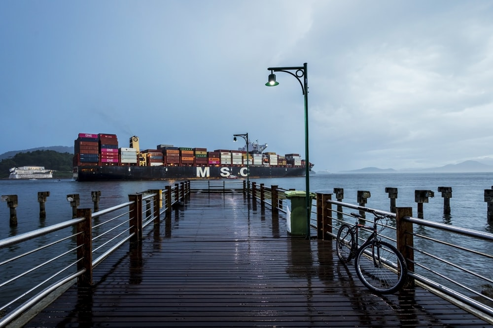 black bicycle on wooden dock during daytime