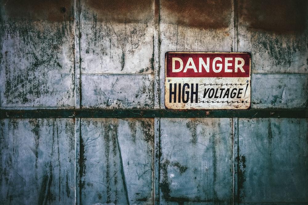 no smoking sign on gray wooden wall