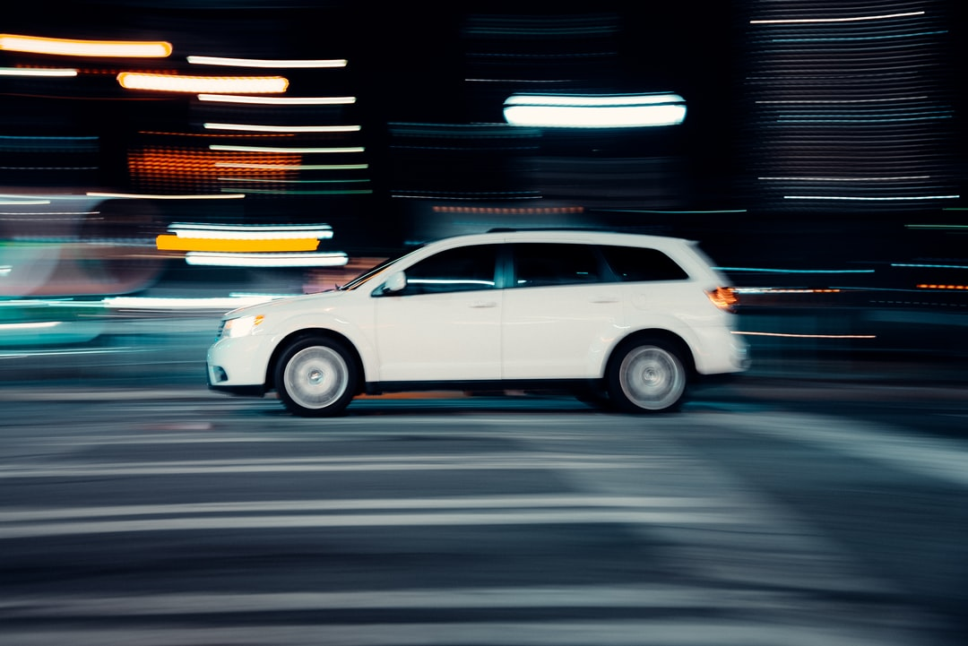 White Sedan On Road During Night Time - unsplash