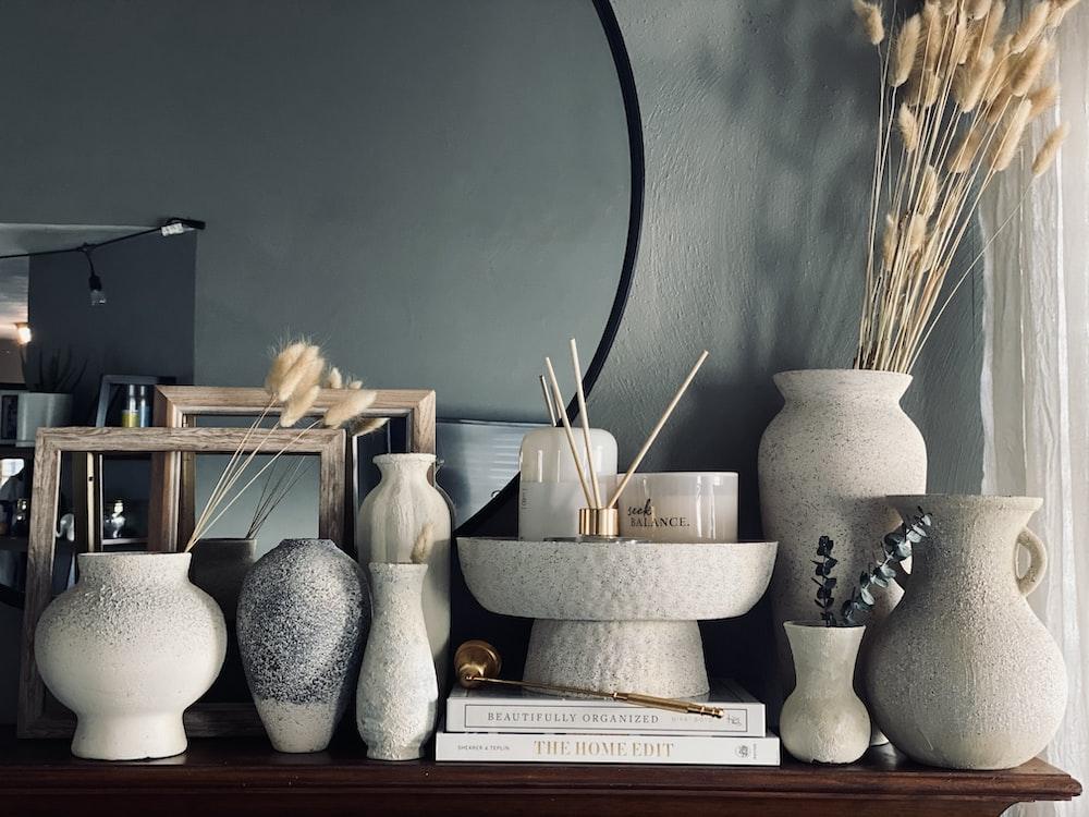 white ceramic vase on white wooden shelf