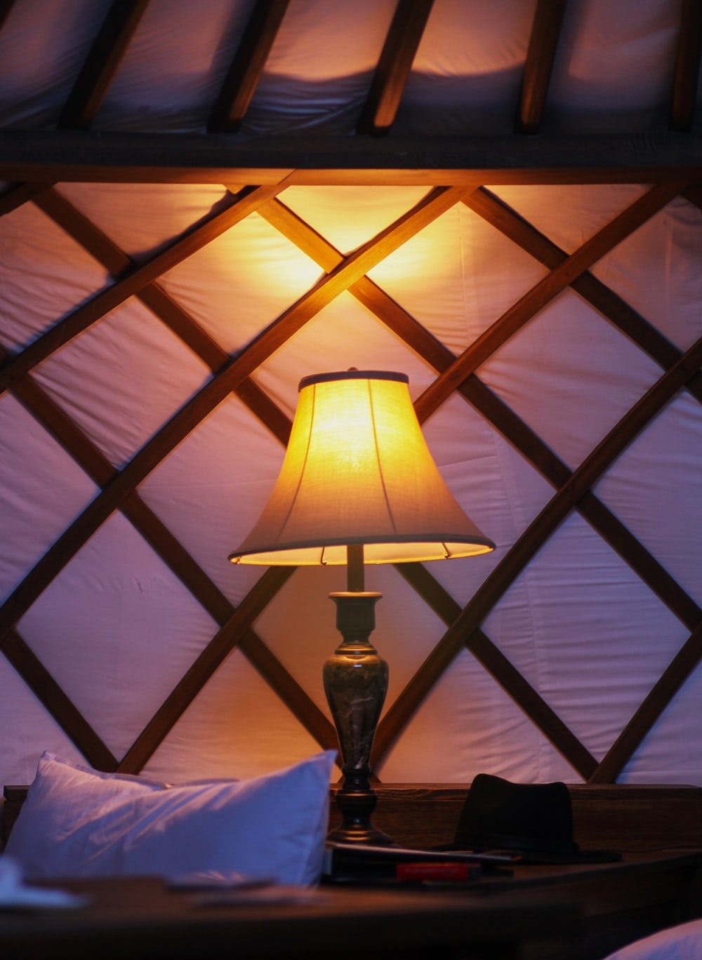 brown table lamp on brown wooden table