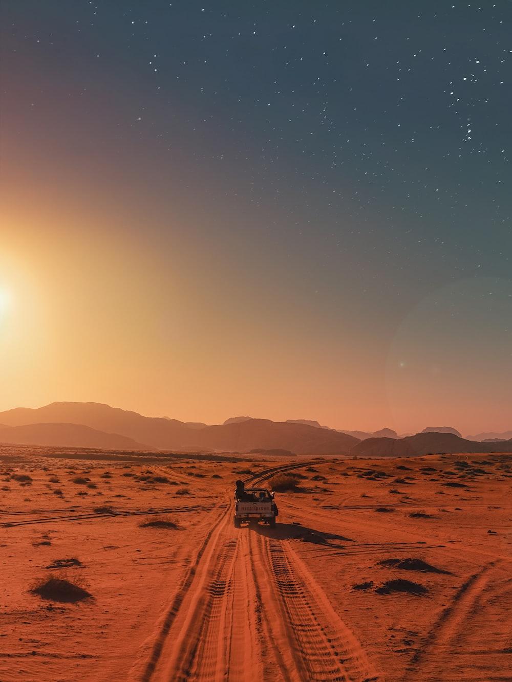 black car on desert during daytime