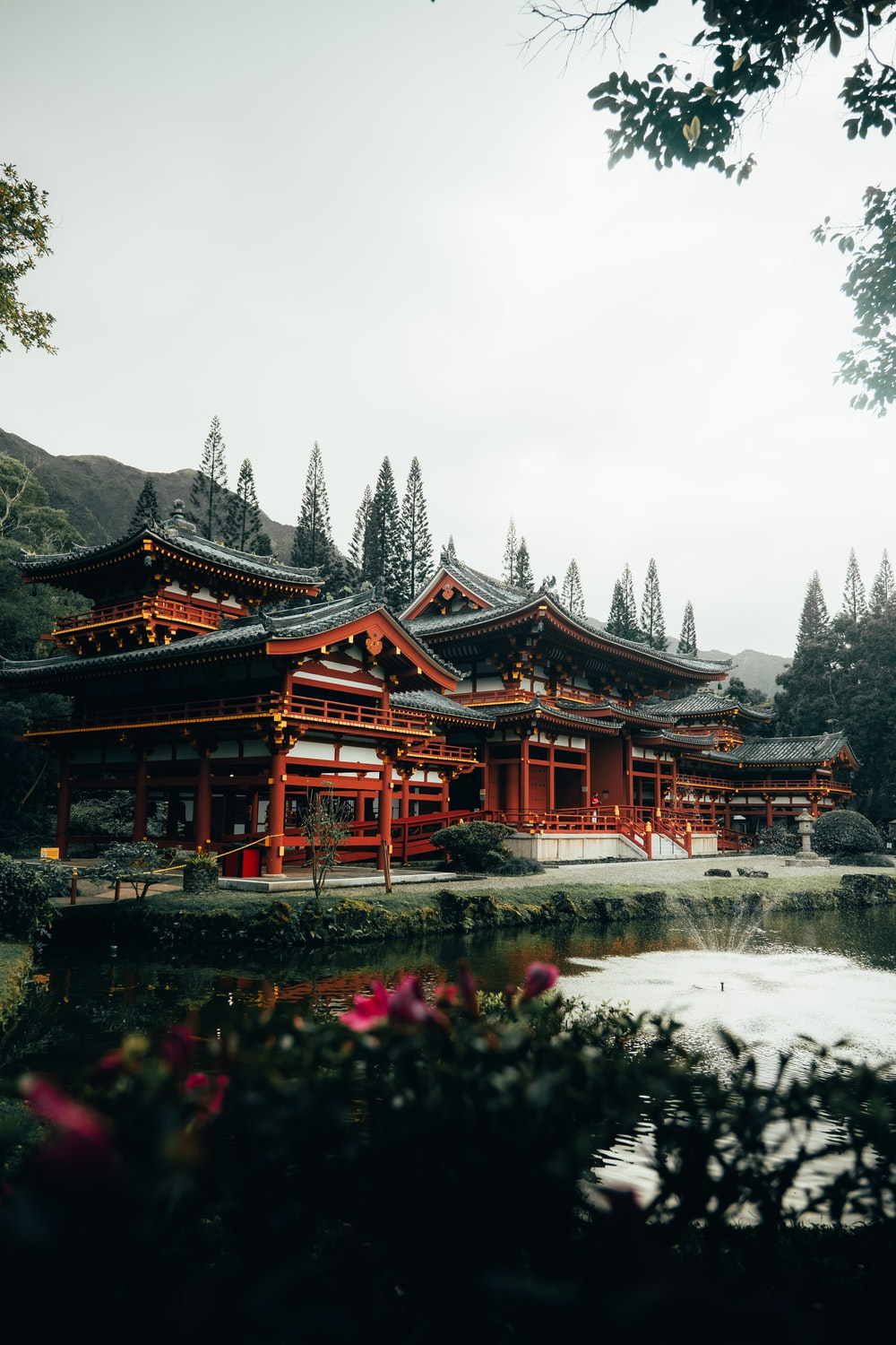 red and brown temple surrounded by trees during daytime