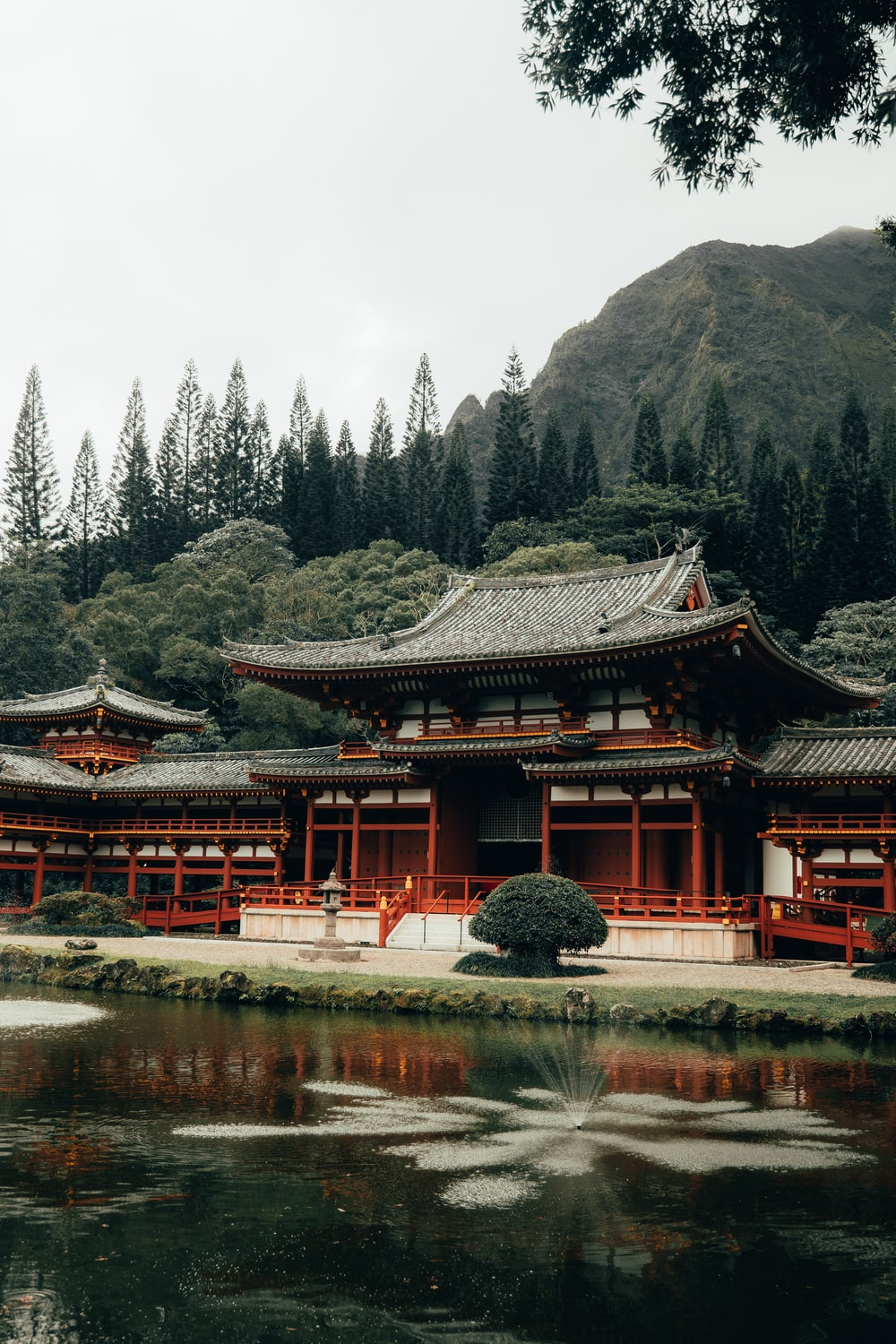 red and black temple near lake