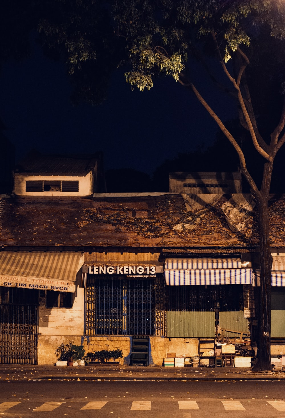brown brick building with lights turned on during night time