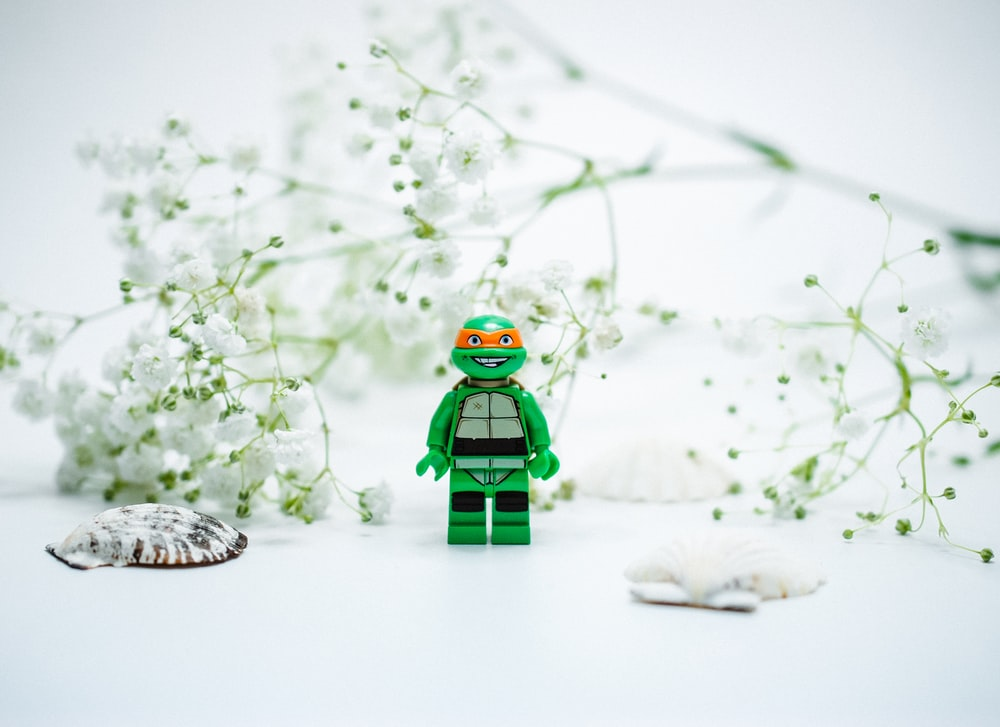 lego minifig on snow covered ground