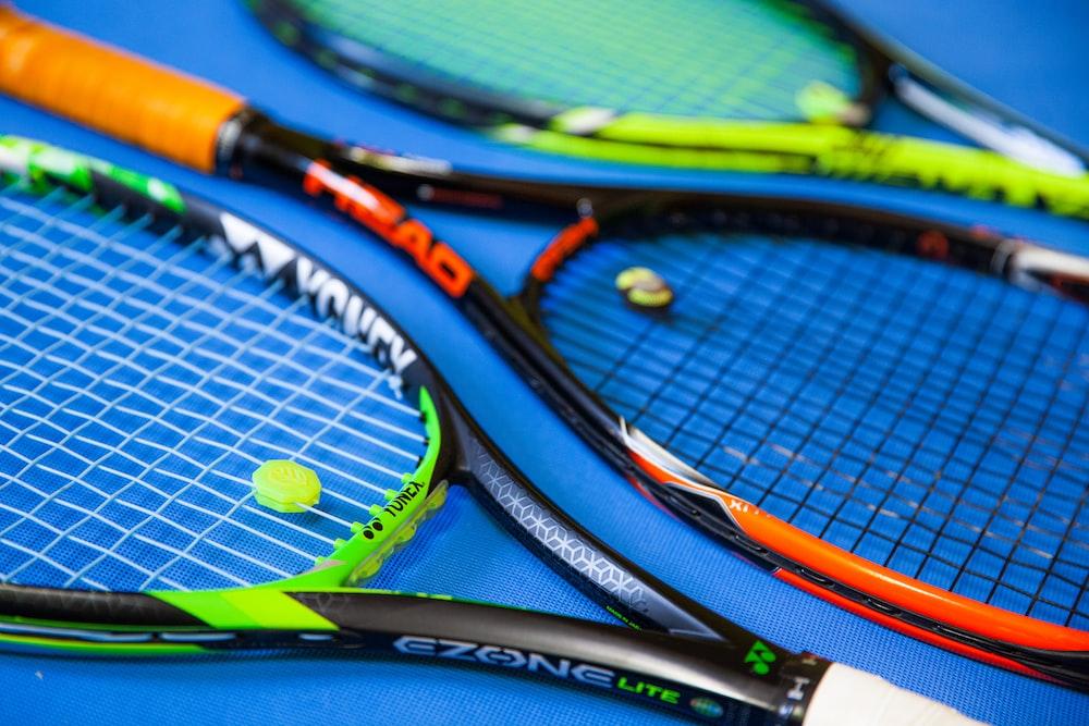 green and black tennis racket