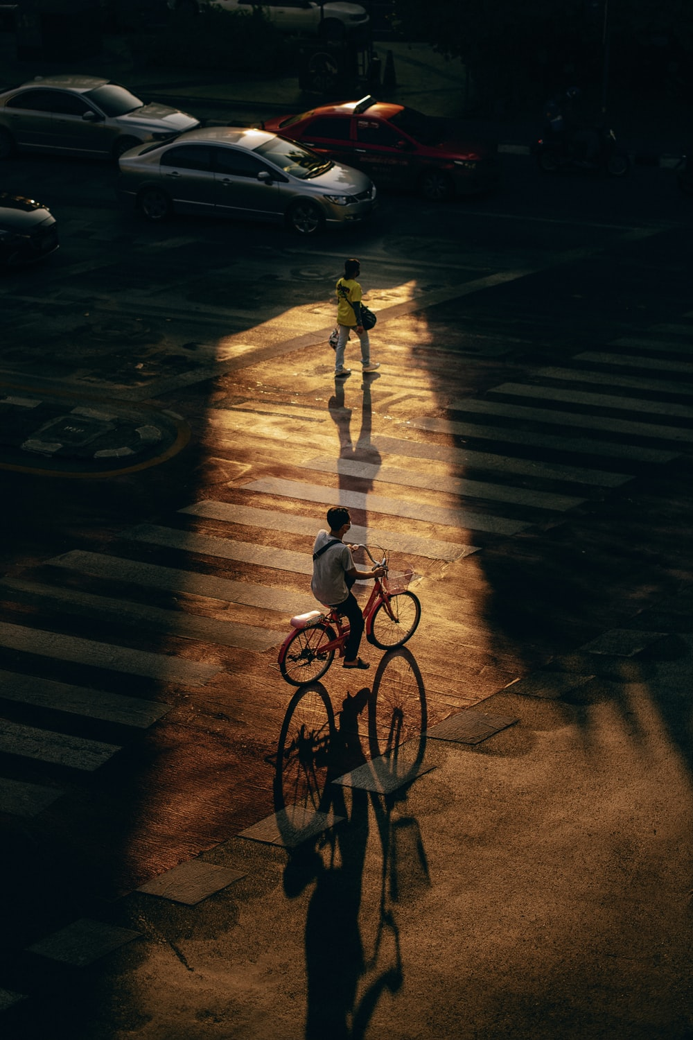 girl in white shirt and pants riding bicycle on road during night time