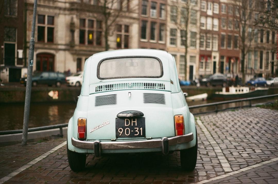 White Volkswagen T-2 Parked On Sidewalk During Daytime - unsplash