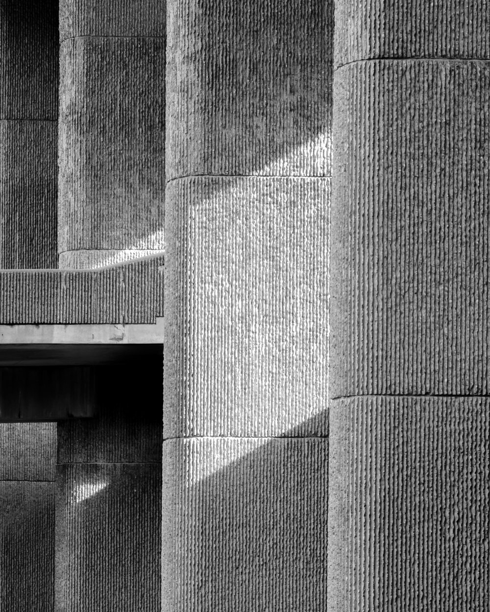 grayscale photo of concrete wall