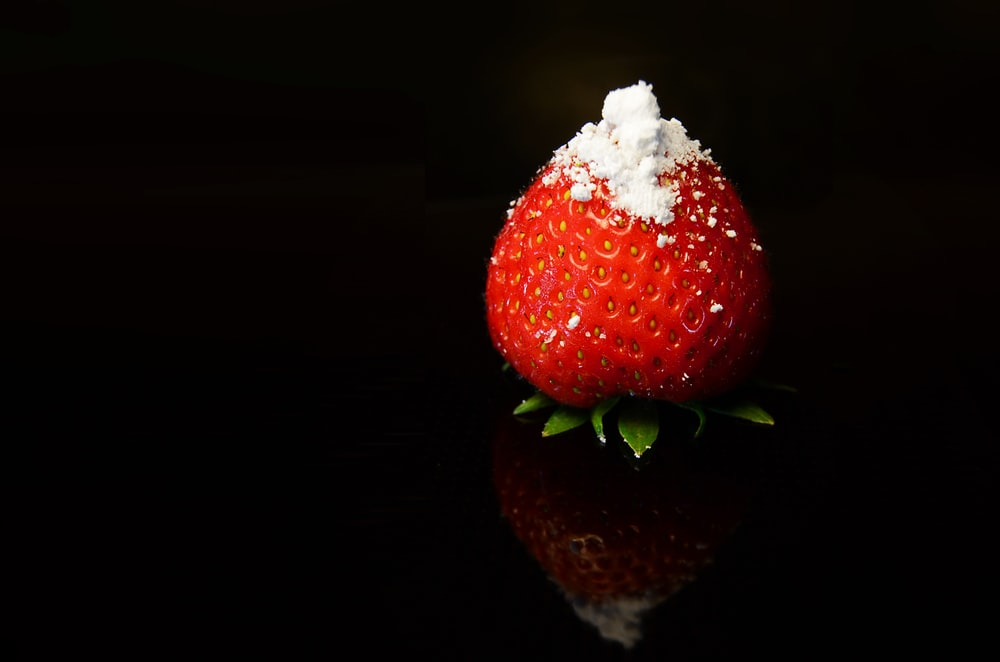 red strawberry fruit with white cream