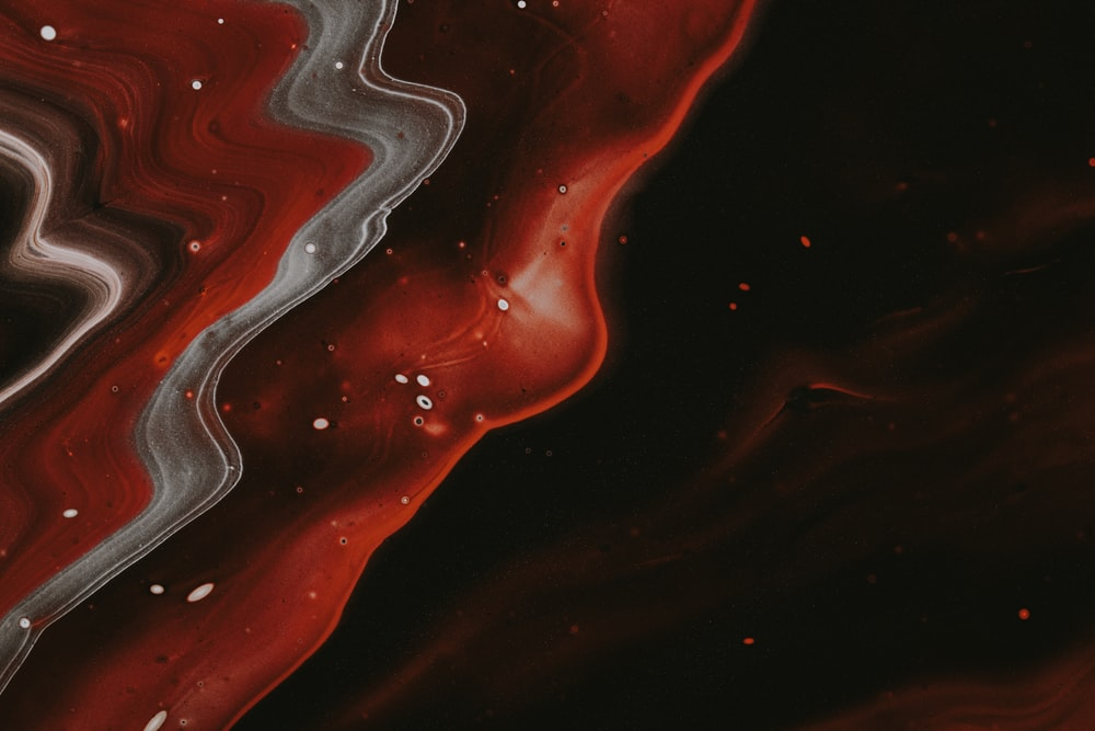 red white and black abstract painting