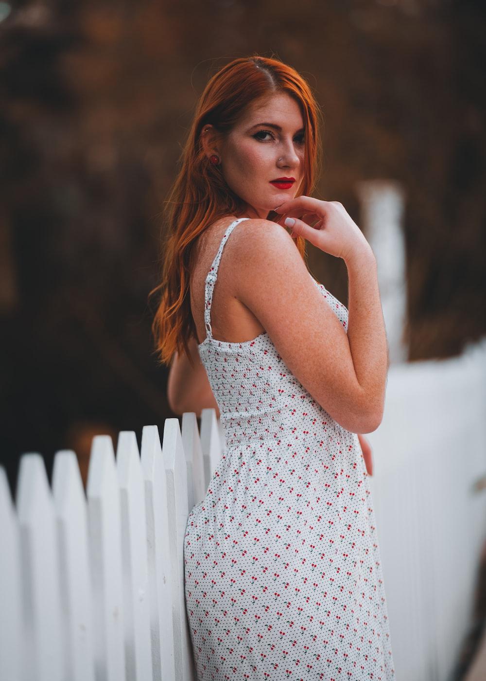 woman in white and black polka dot spaghetti strap dress