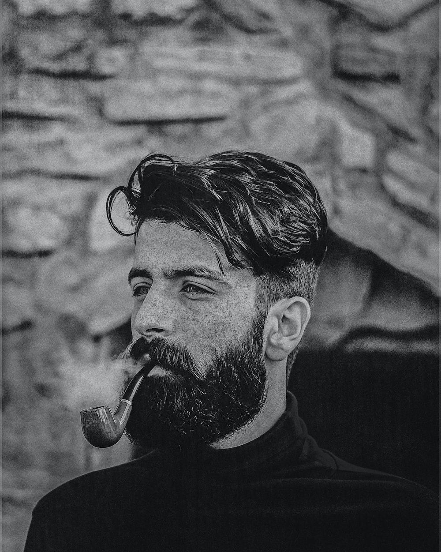 man in black crew neck shirt smoking