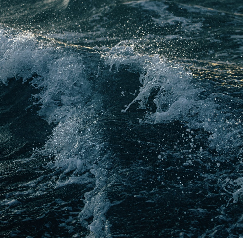 water waves hitting the shore