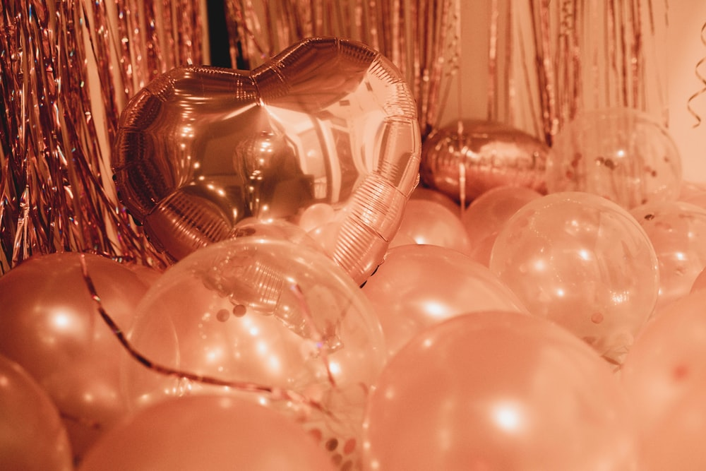 clear glass ball decors on brown wooden table