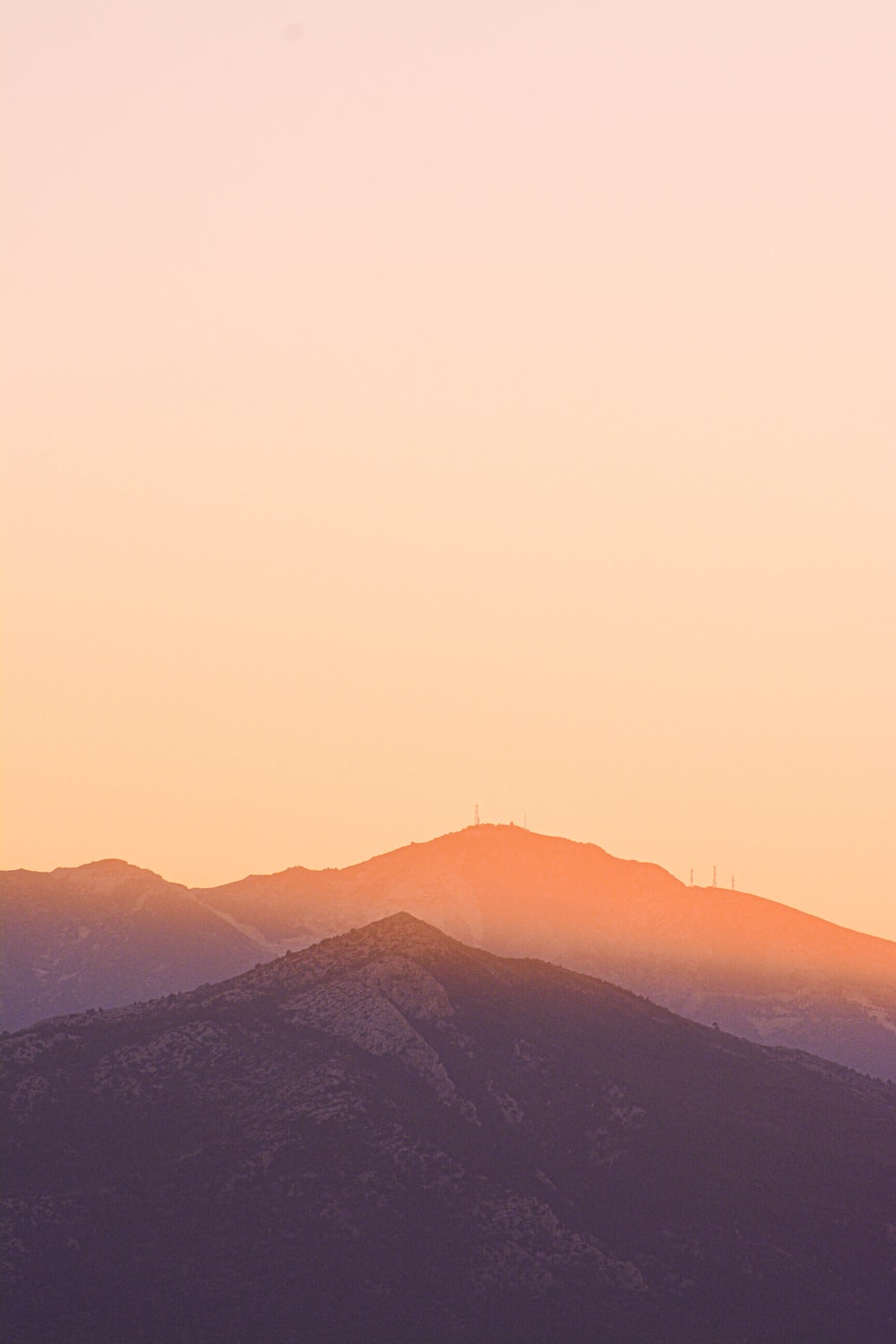 silhouette of mountains during sunset